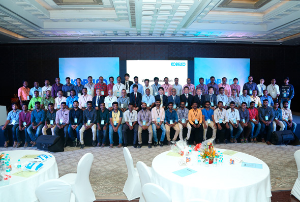 Group photo of reception celebrating transition to the new company
