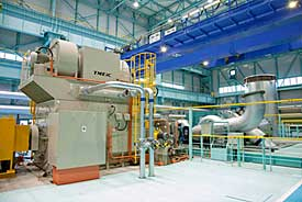 Large-capacity centrifugal compressor and motor (at left) under test run