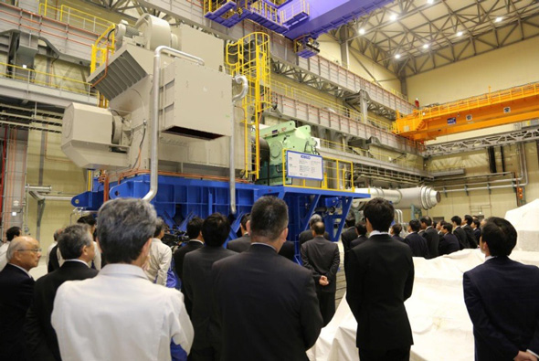 Participants at the opening ceremony view a large-capacity compressor ready to under testing.