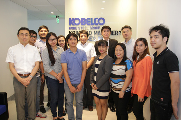 The staff of Kobelco Machinery Philippines with President Miyoshi Sagesaka (back row, second from the right). Mr. Sagesaka is concurrently general manager of the Rotating Machinery Plant at Kobe Steel's Takasago Works in Takasago, Hyogo Prefecture, Japan.